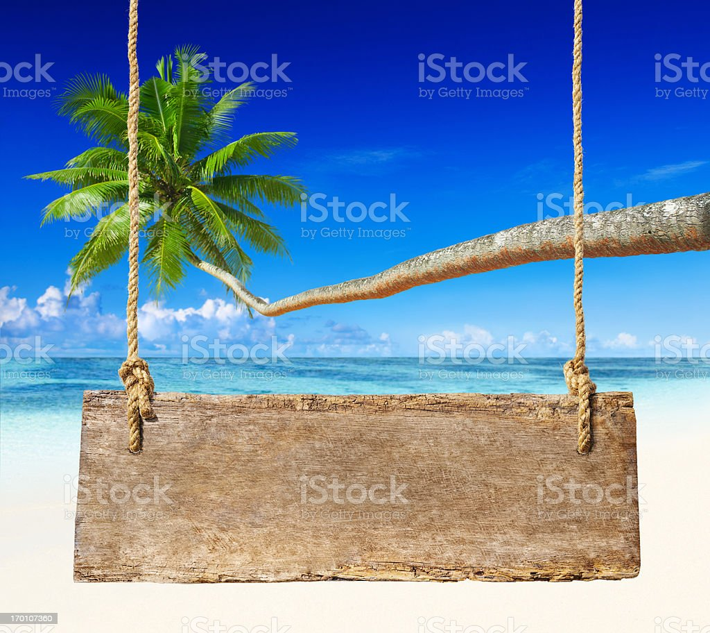 Wood sign on the beach. royalty-free stock photo