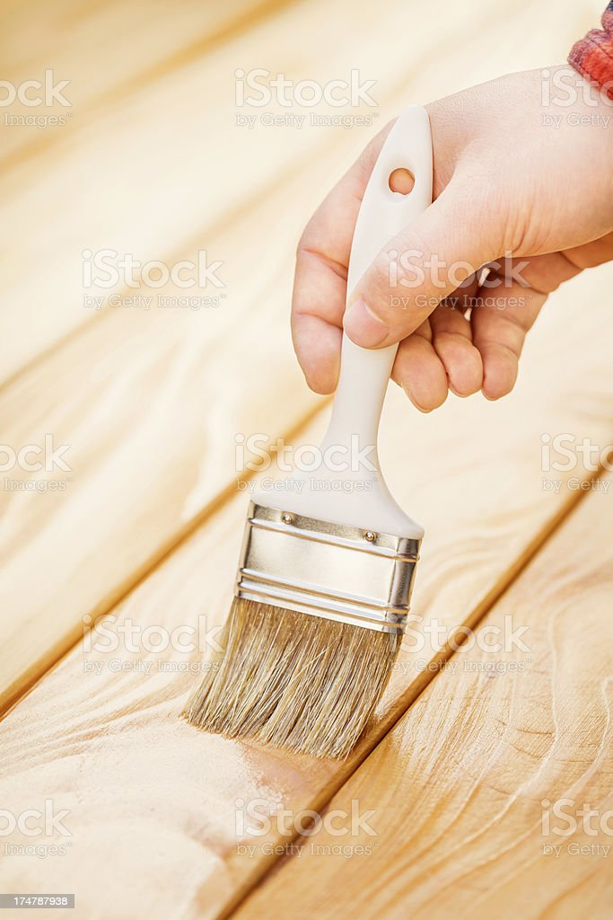 Wood stain application royalty-free stock photo