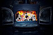 Wood stove fire burning logs