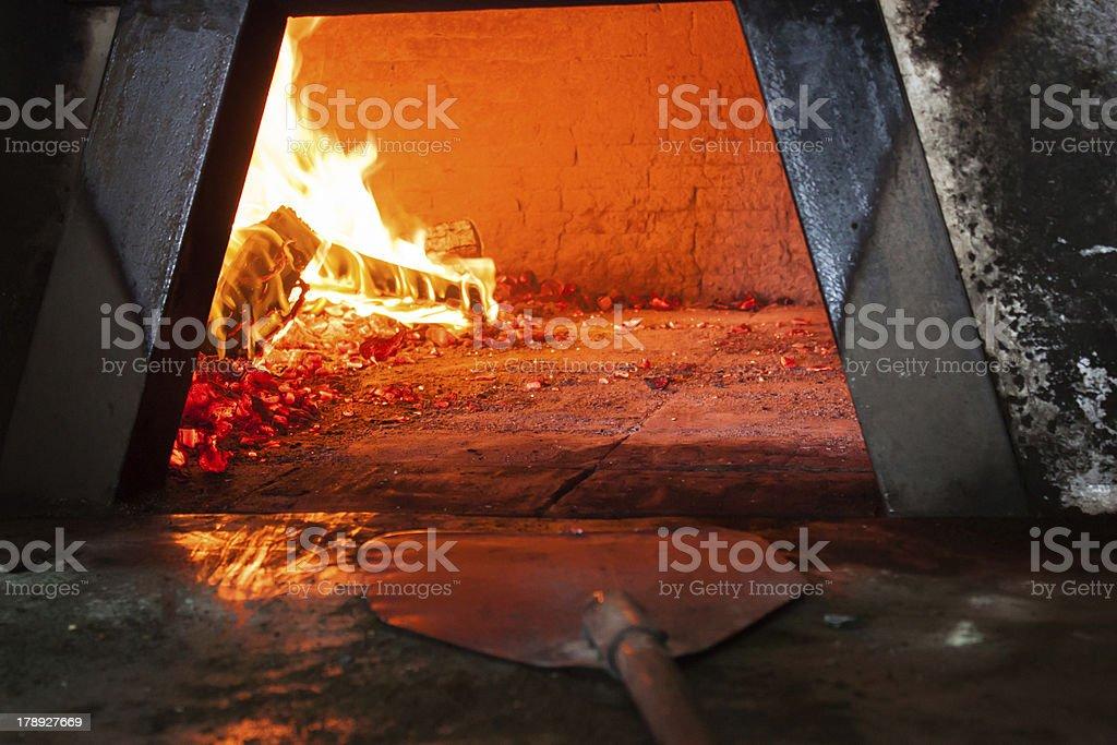 Wood stove firebox and pizza peel stock photo
