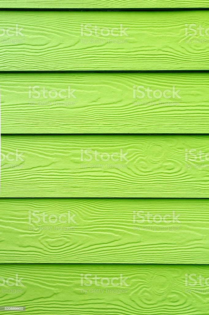 Wood structure painted in green stock photo