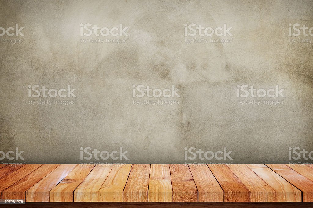 Wood tabe in front of concrete wall stock photo