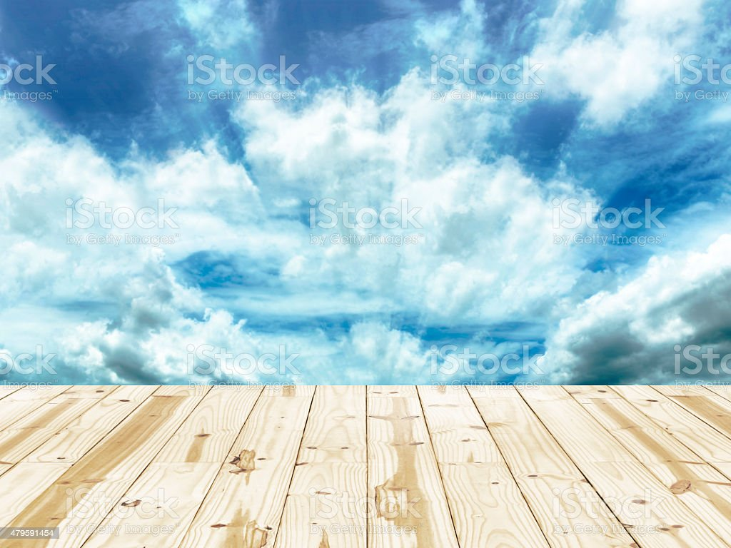 Wood table and Radial blured in blue sky backgrounds. royalty-free stock photo