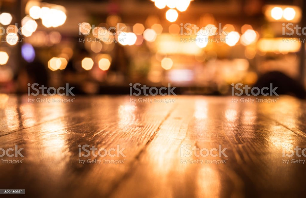 Wood table on blur cafe (restaurant) background stock photo
