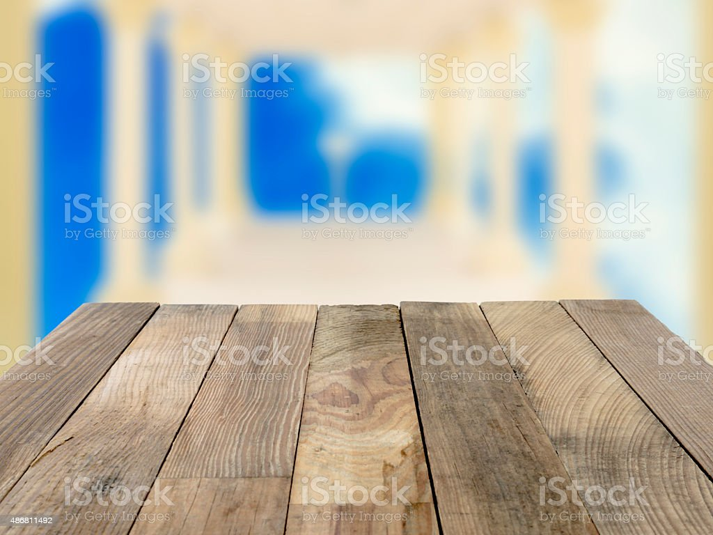 Wood table top on blue blurred backgrounds. royalty-free stock photo