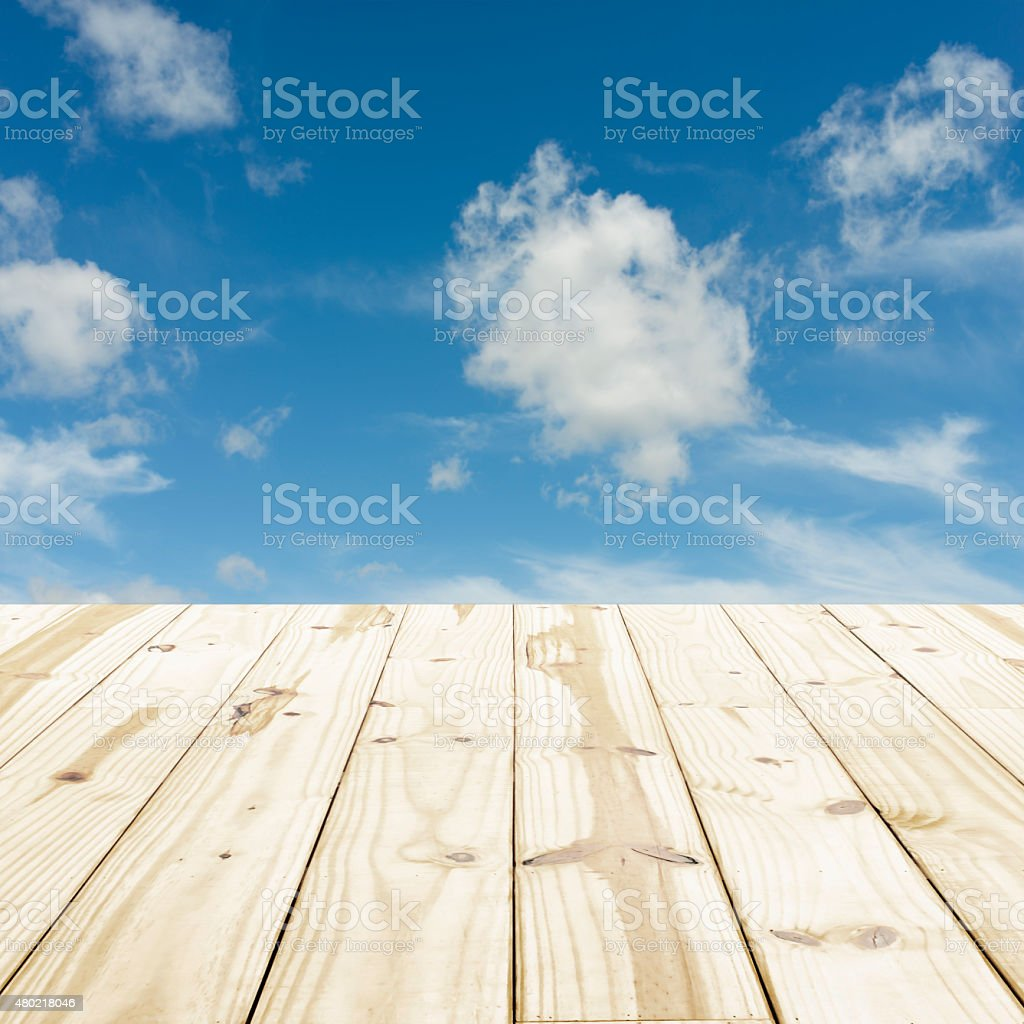 Wood table top on blue sky blurry backgrounds. royalty-free stock photo