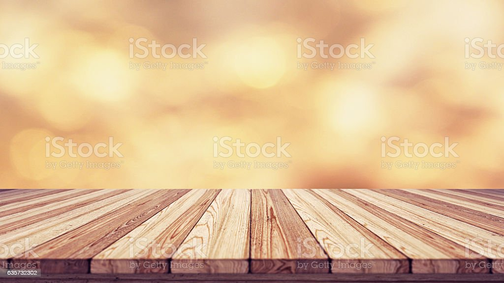 Wood table top on blur bokeh background. stock photo
