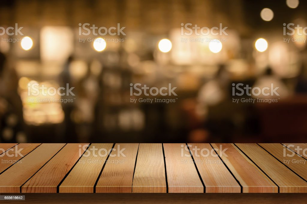 Wood table top on blur bokeh cafe background can be used for display or montage your products stock photo