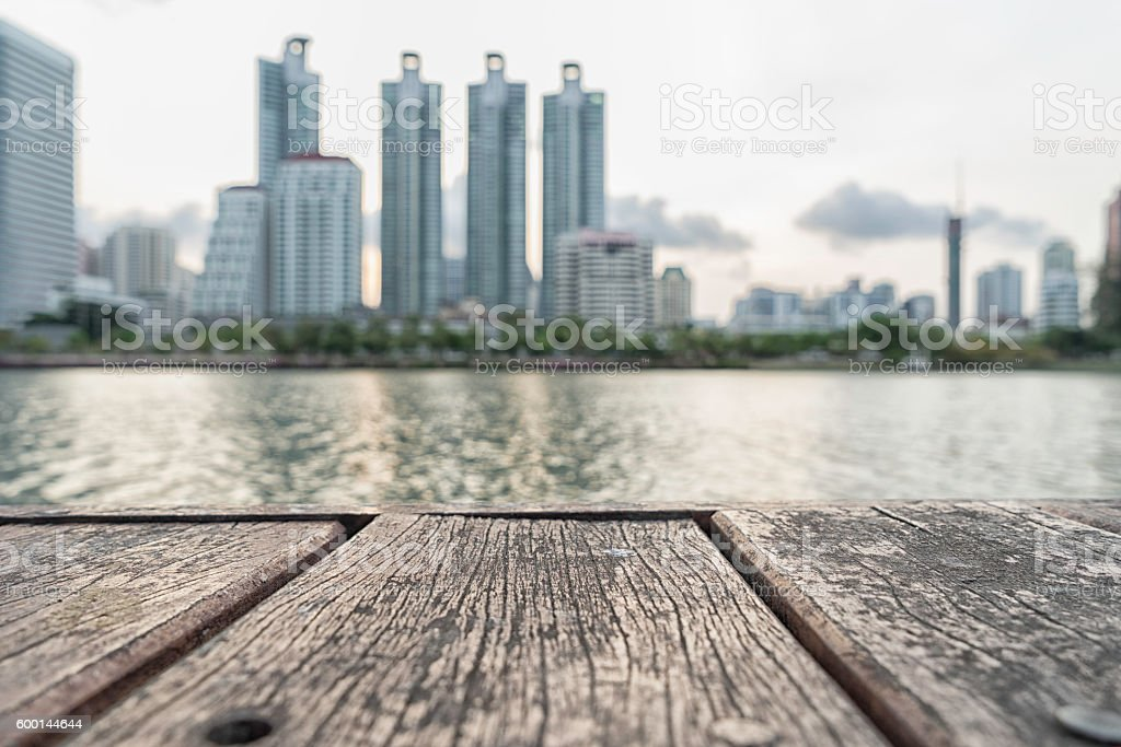 wood table top on blur cityscape background stock photo