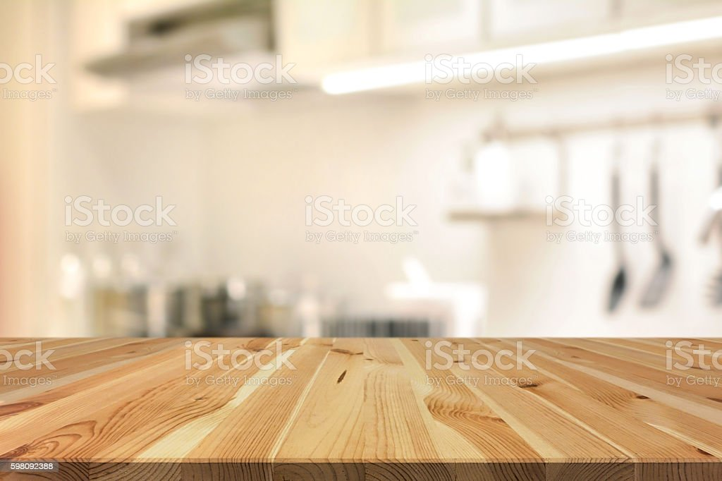Kitchen Table Background wood table top on blur kitchen interior background stock photo
