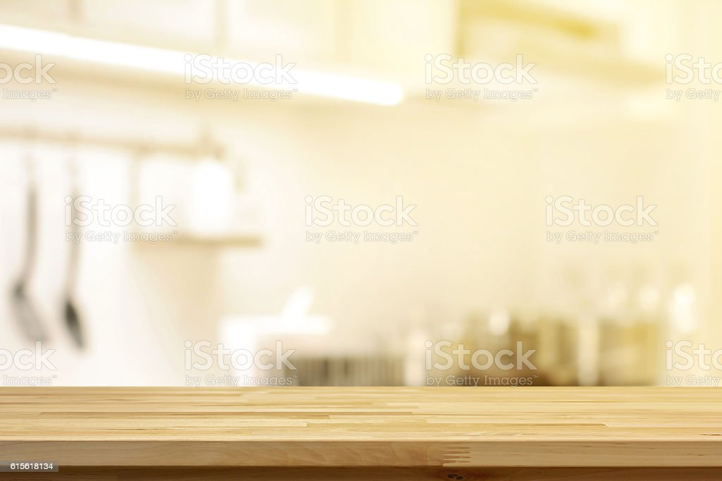 Kitchen Table Top Background wood table top on blur kitchen interior background stock photo