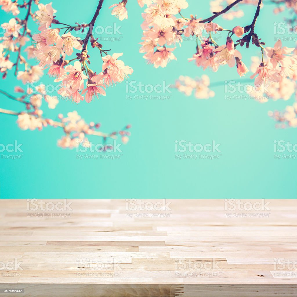Wood table top on blur pink Sakura flower background stock photo