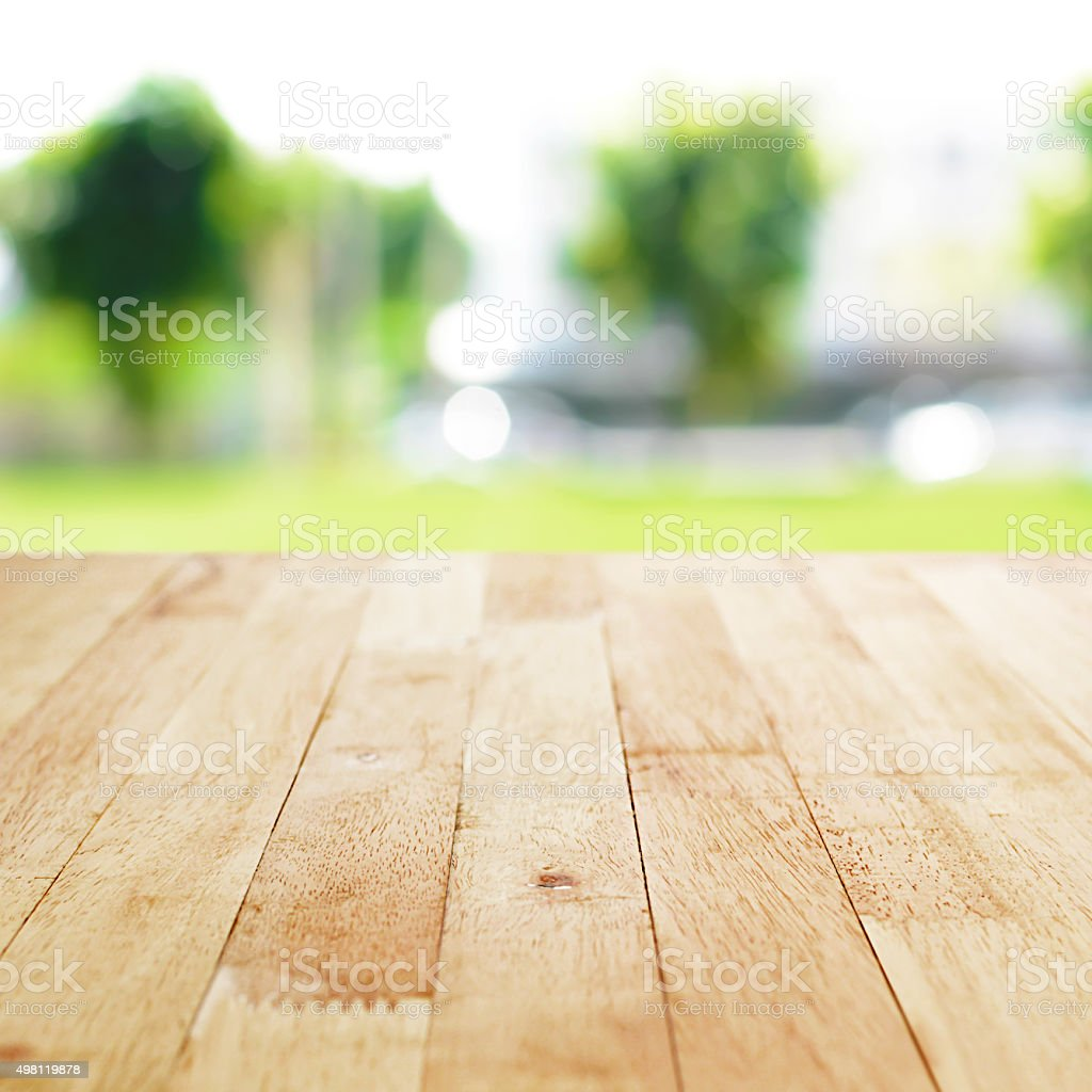 Kitchen Table Top Background wood table top on blurred green nature abstract background stock