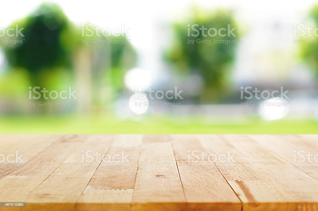 Kitchen Table Top Background wood table top on blurred green nature background stock photo