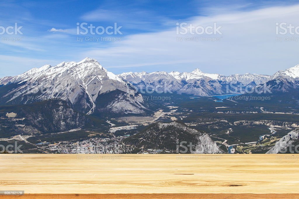 Wood table top on blurred green nature background stock photo