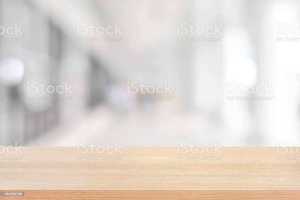 Wood table top on blurred hallway background stock photo