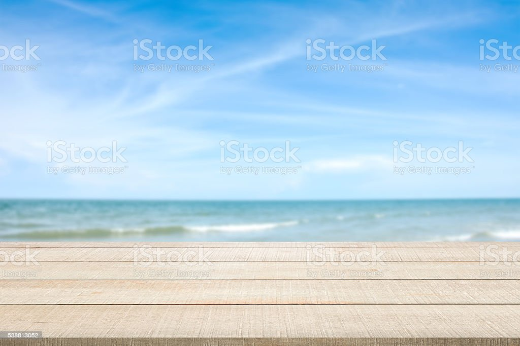 wood table top on blurred seascape stock photo