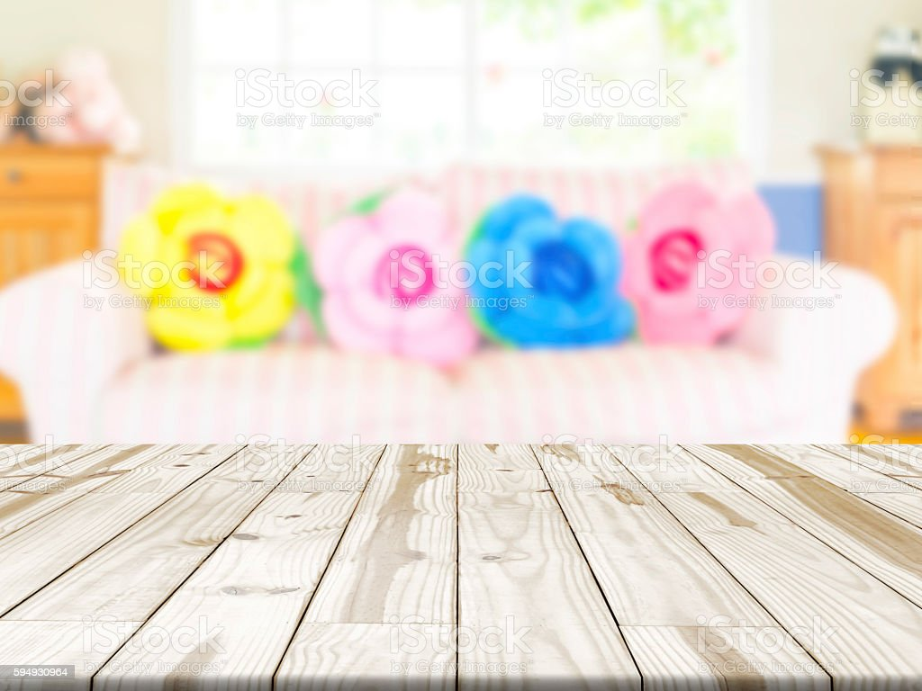 Empty wood table and blurred living room background stock photo - Wood Table Top On Blurry Interior Living Room In Background Royalty Free Stock Photo