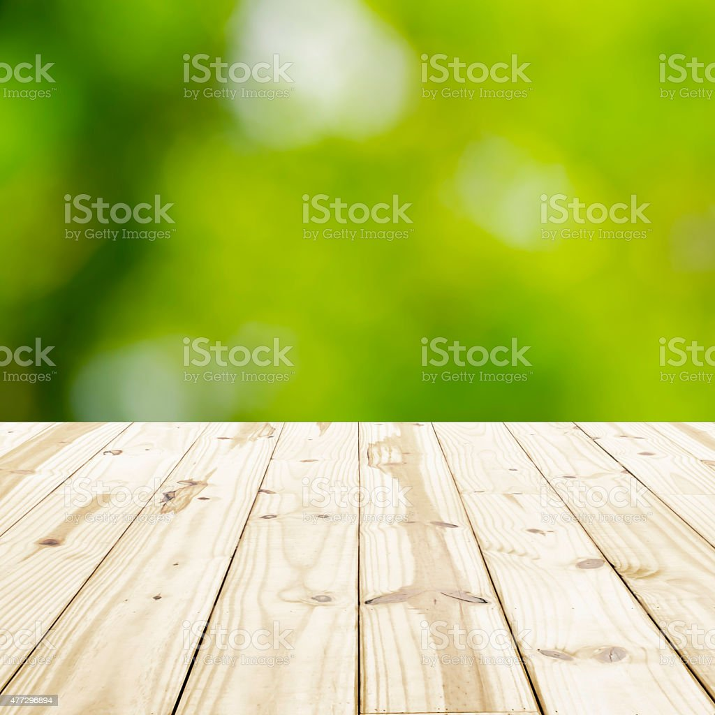 Wood table top on green blurry backgrounds. royalty-free stock photo