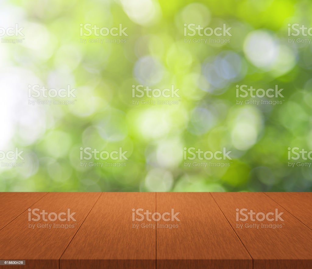 Wood table top on green bokeh background stock photo