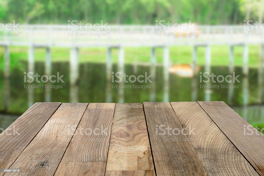 Wood table top on Green nature blurred backgrounds. royalty-free stock photo