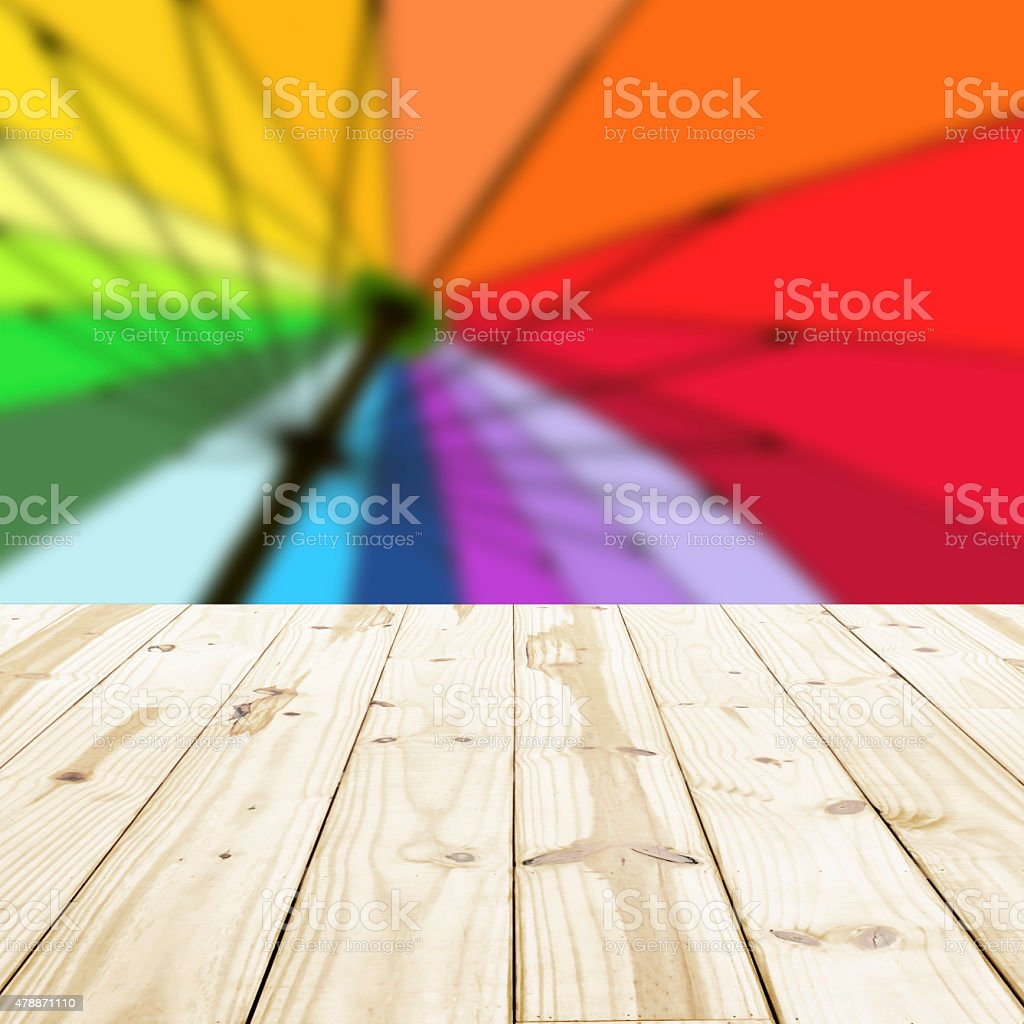 Wood table top on rainbow blurry backgrounds. royalty-free stock photo