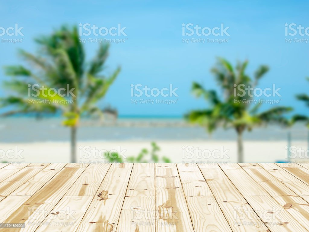 Wood table top on sea beach blurry backgrounds. stock photo