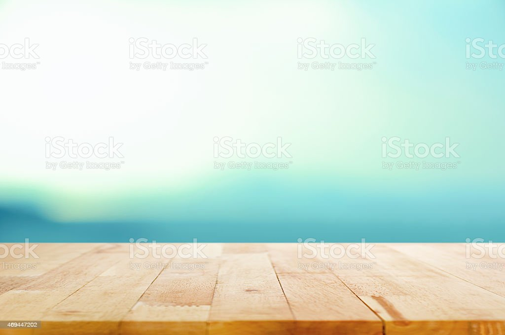 Wood table top on white blue gradient background stock photo