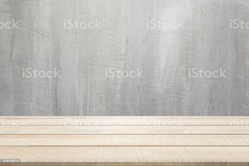 wood table top panel on concrete background stock photo