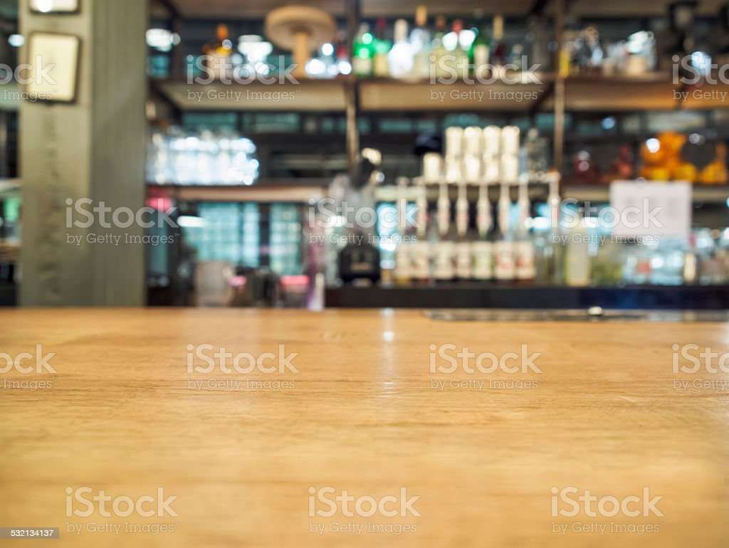 Wood table with bar restaurant background stock photo