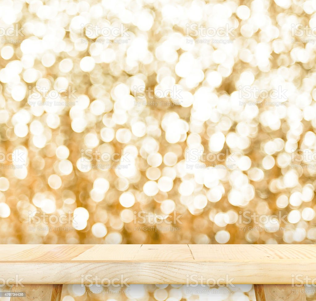 Wood Table with bokeh golden sparkling background,Empty room for stock photo