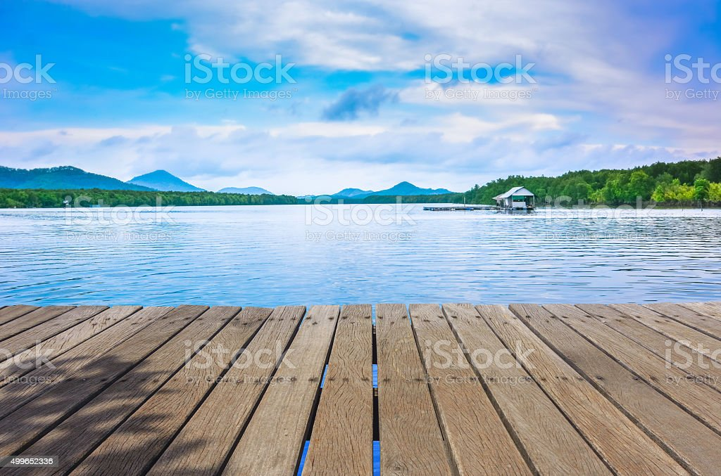 wood terrace and Beautiful Rivers and Mountains in evenning stock photo
