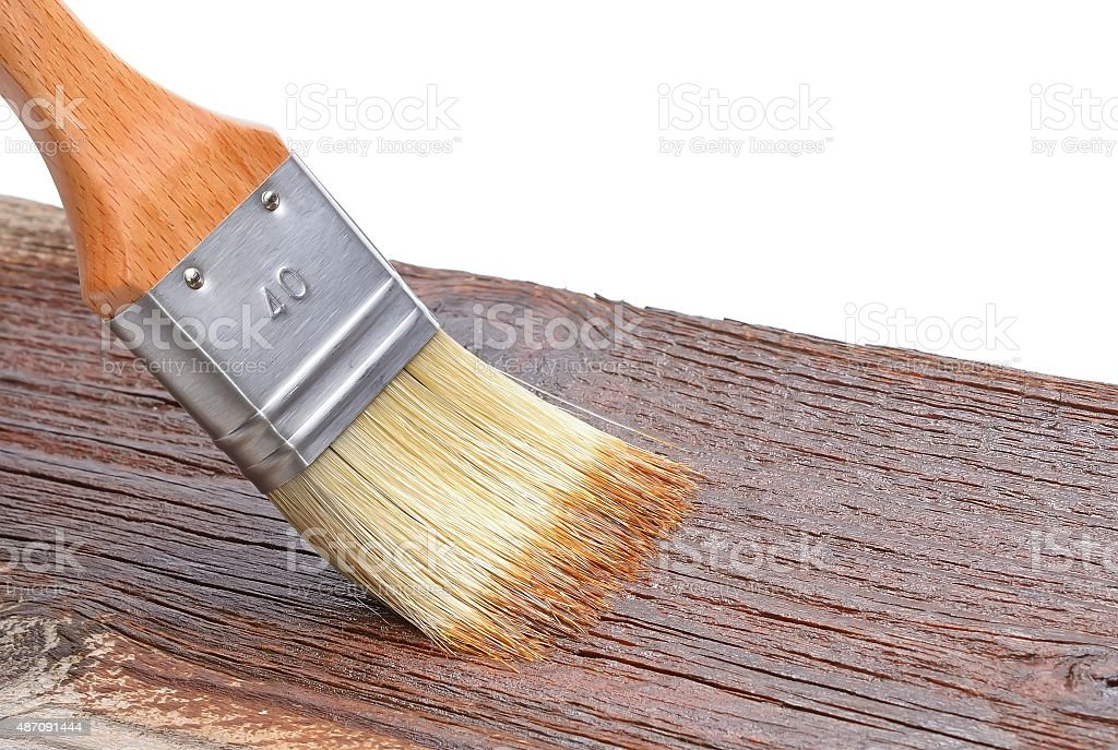 Wood texture and paintbrush stock photo