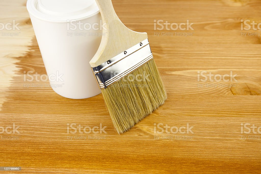 Wood texture, can and paintbrush / housework stock photo