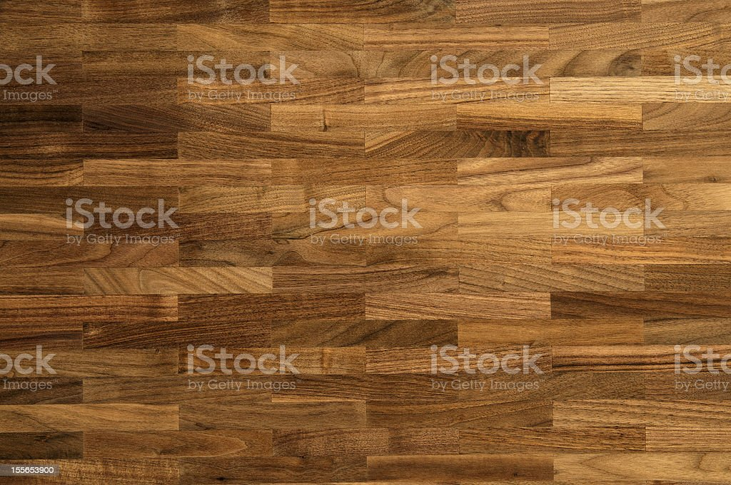 Wood texture - walnut parquet floor stock photo