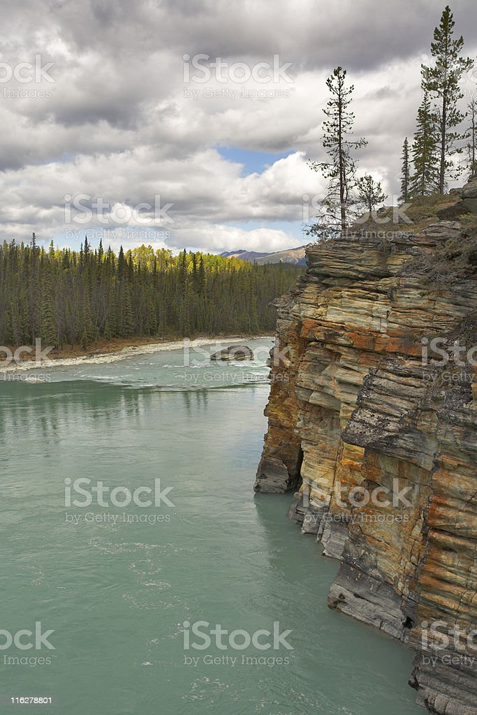 Wood, the river and clouds royalty-free stock photo