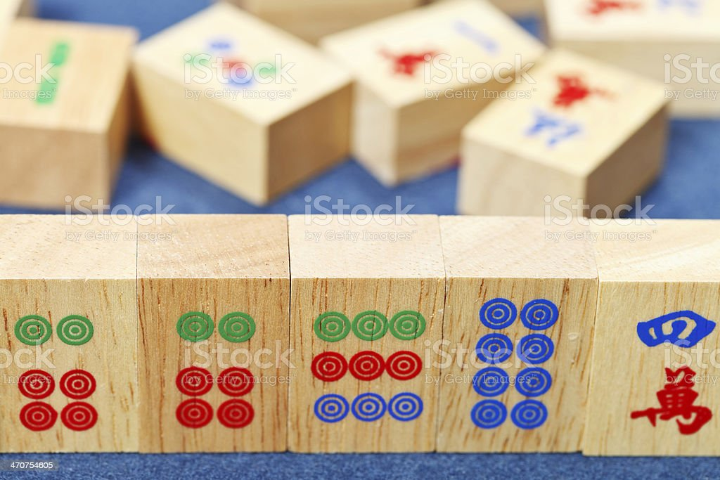 wood tiles closeup in mahjong game on blue cloth stock photo