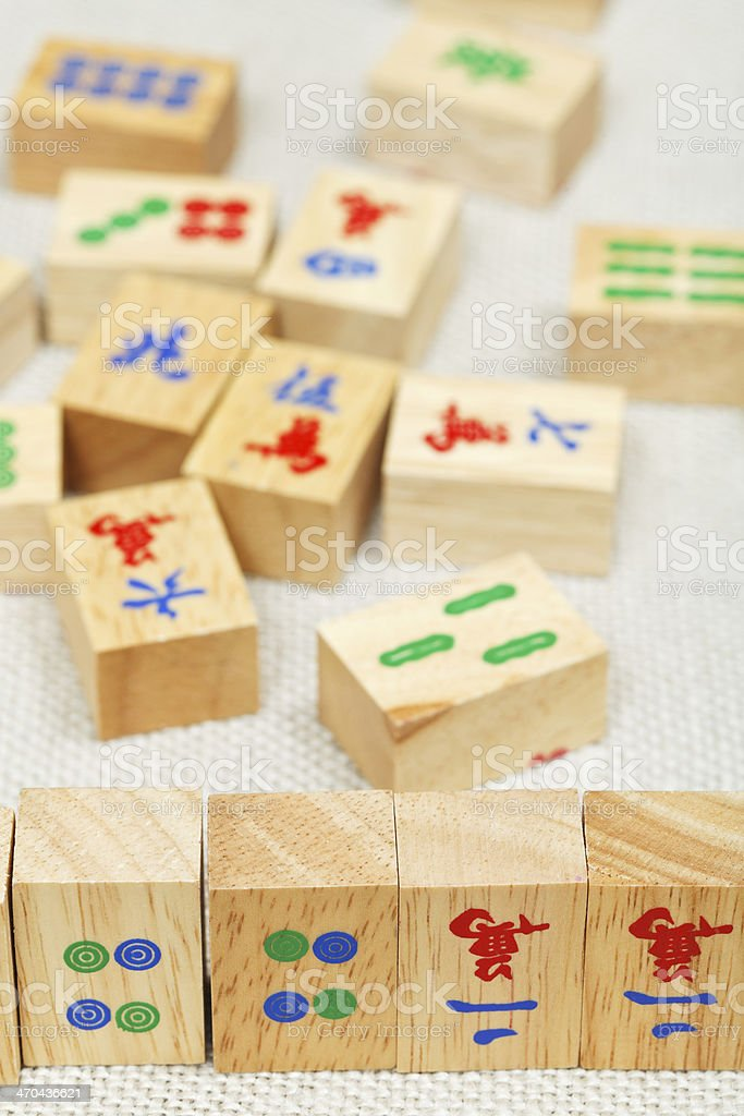wood tiles in mahjong game on textile table stock photo