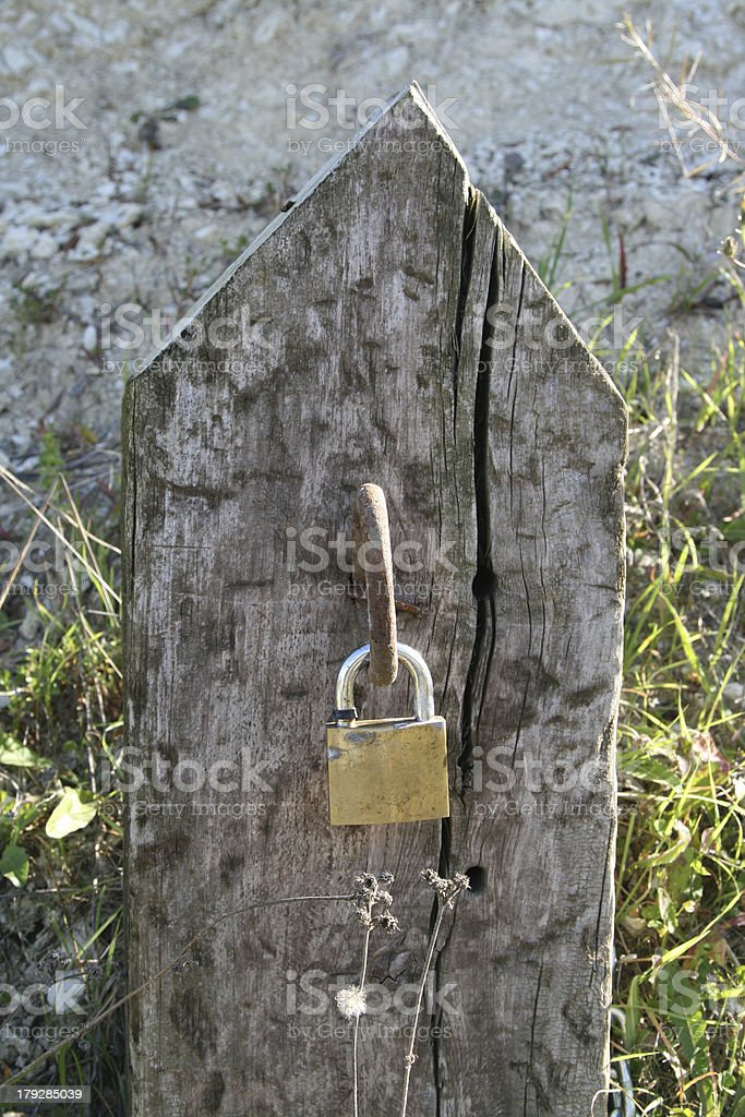 wood tombstone with padlock royalty-free stock photo