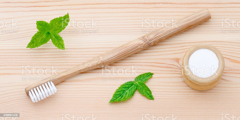 wood toothbrush and xylitol, soda, powder, salt, mint on wooden stock photo