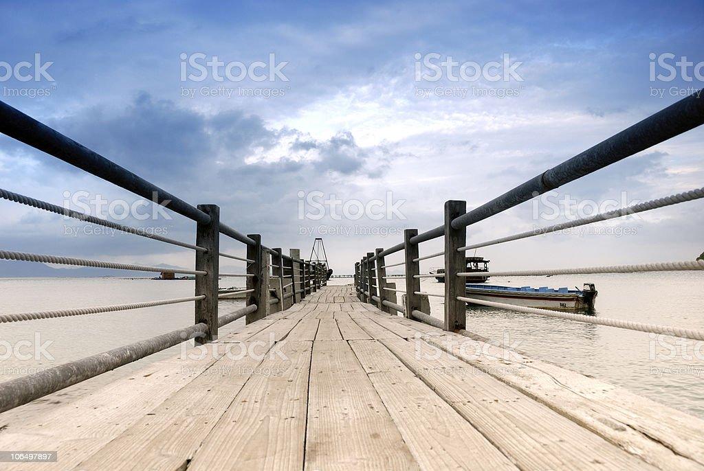 Wood walkway to the ocean stock photo