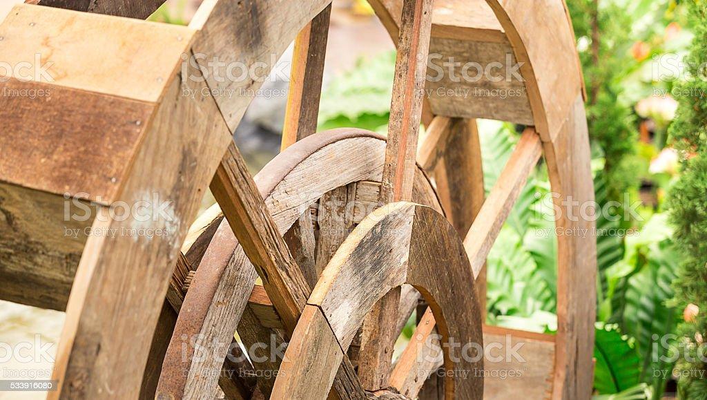 wood water turbine in farm stock photo
