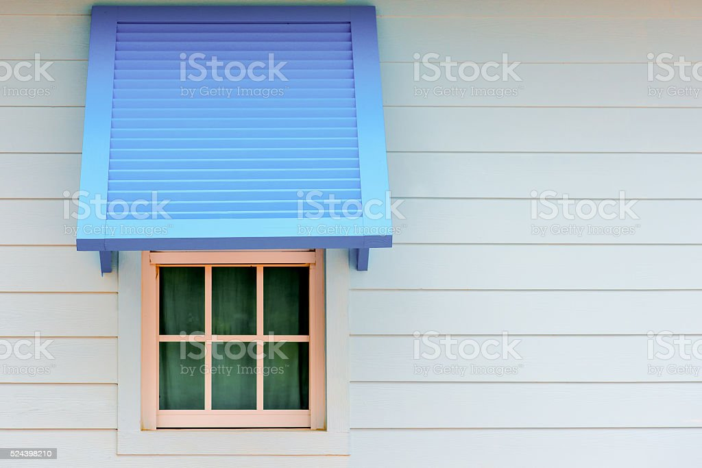 Wood window with blue paravane in natural light stock photo