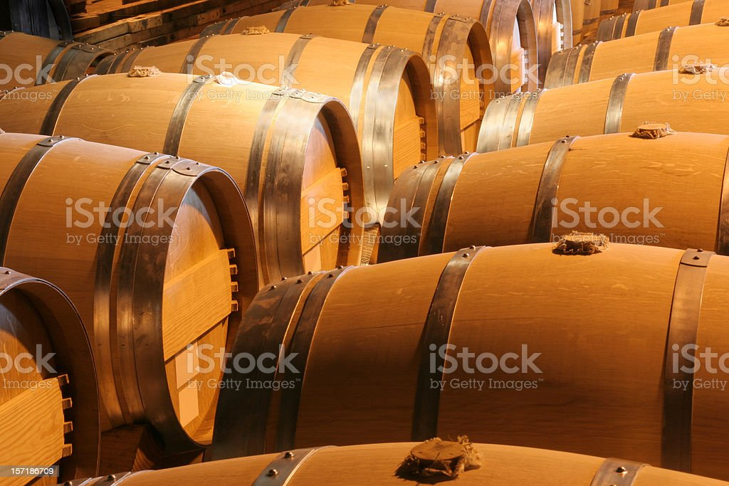 Wood Wine Barrels in Winery Cellar in Napa Valley California royalty-free stock photo