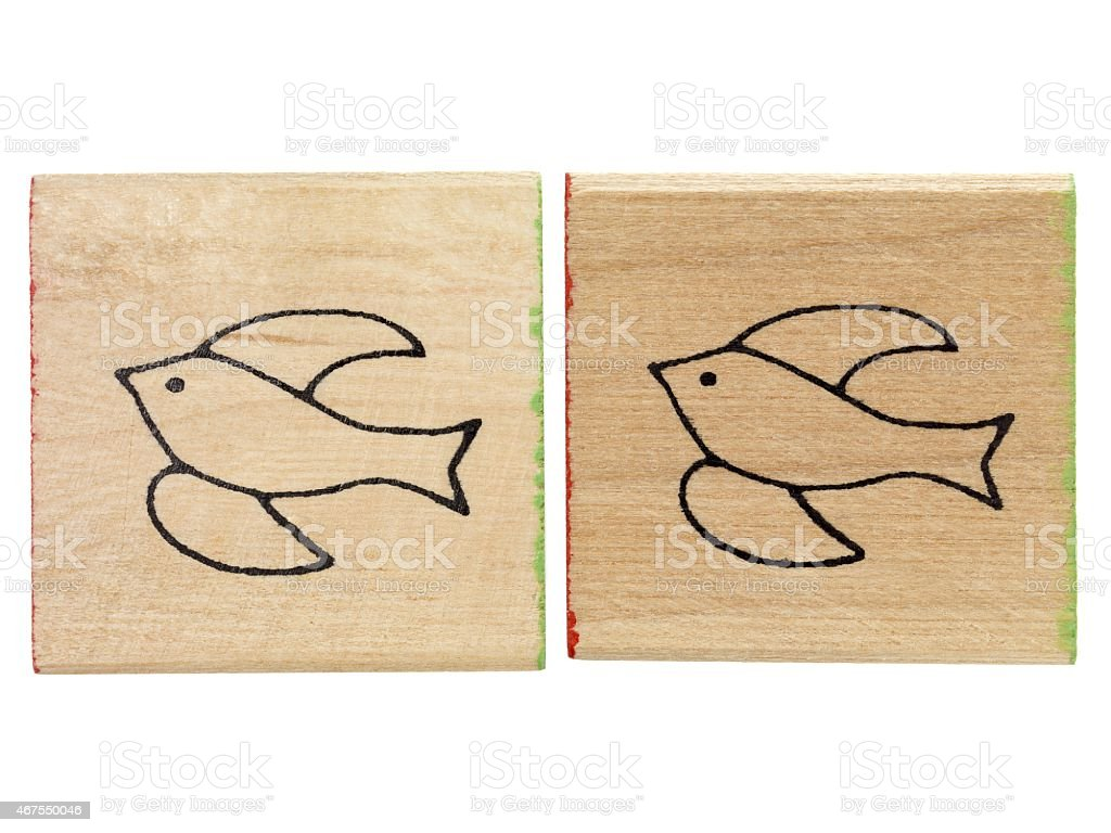 wood with drawing of bird stock photo