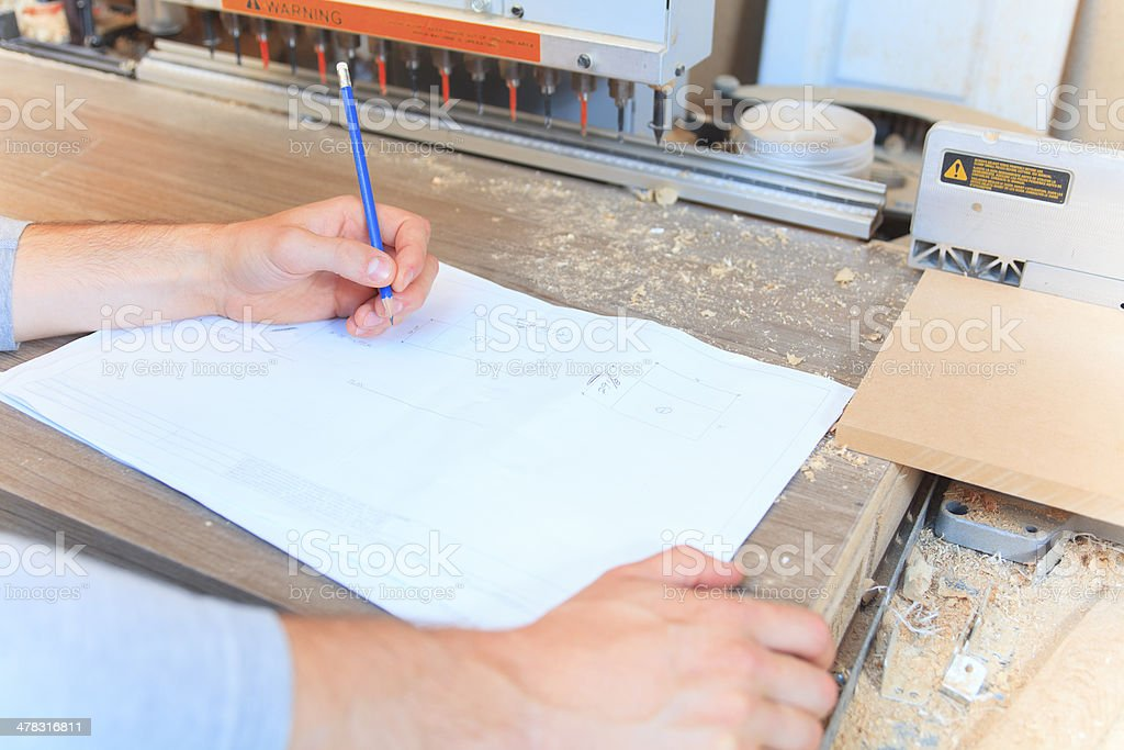 Wood Worker - Draw Plan royalty-free stock photo
