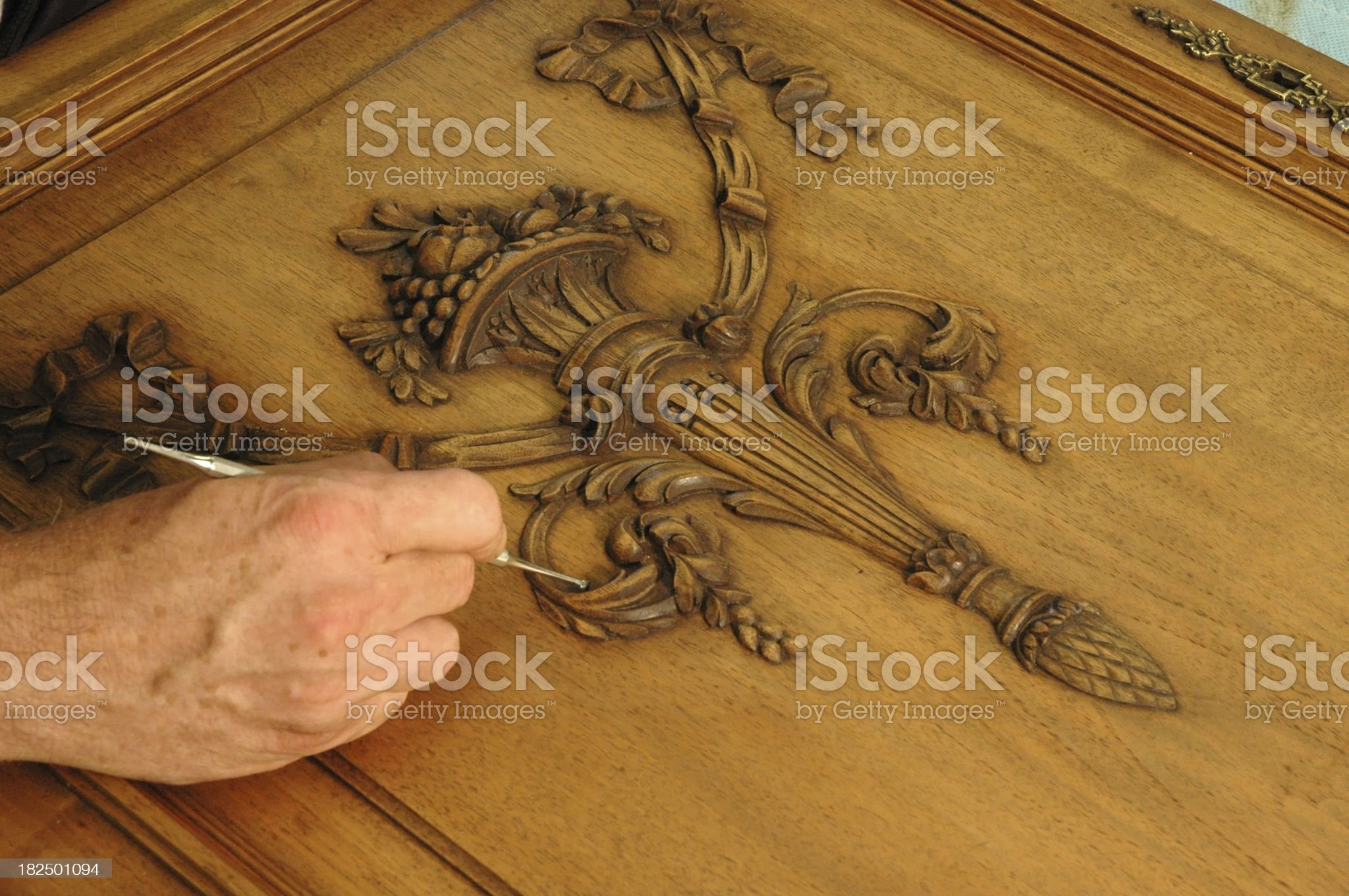 Wood worker repairing oak cabinet door royalty-free stock photo