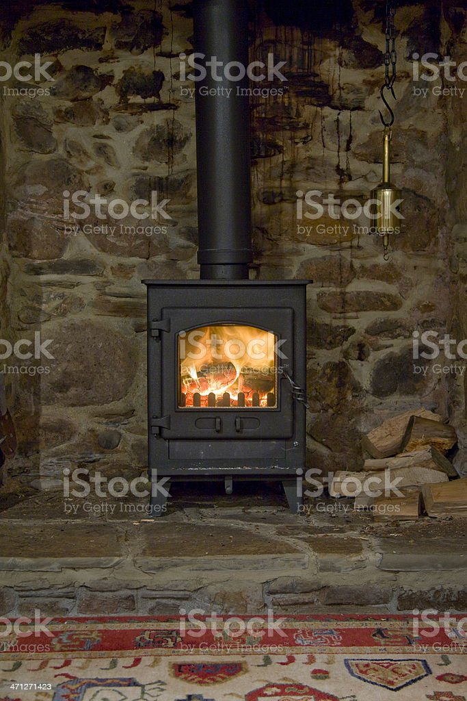 A wood-burning stove inside of an older home  stock photo