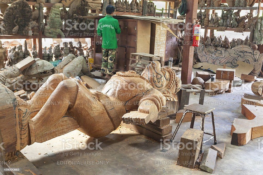 Woodcarver outside Sanctuary of Truth Thailand. royalty-free stock photo