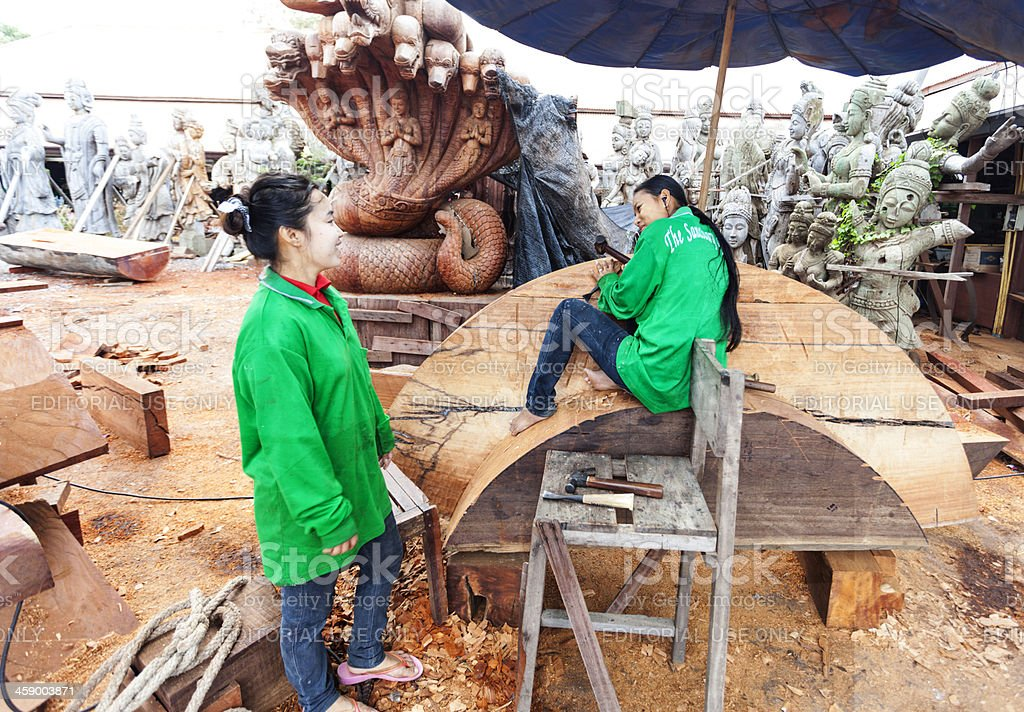 Woodcarvers outside Sanctuary of Truth Thailand. royalty-free stock photo